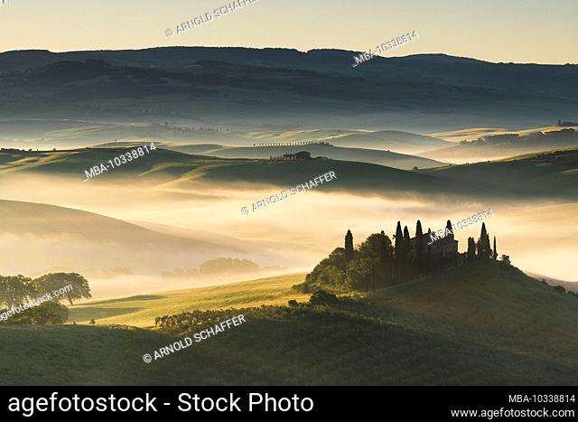 Val d'Orcia, Tuscany, Italy, morning mood at sunrise, view of the country house Belvedere near San Quirico d–'Orcia