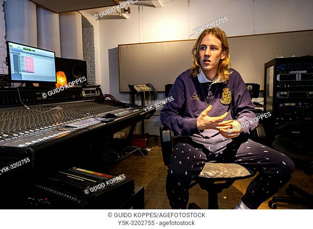 Berlin, Germany. Lucas at the sound studio recording and producing modern, popular music, beats and tracks