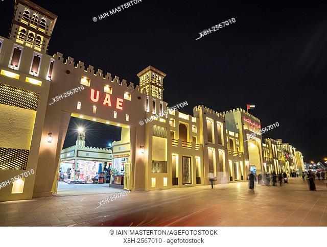Illuminated UAE pavilion at night at Global Village 2015 in Dubai United Arab Emirates