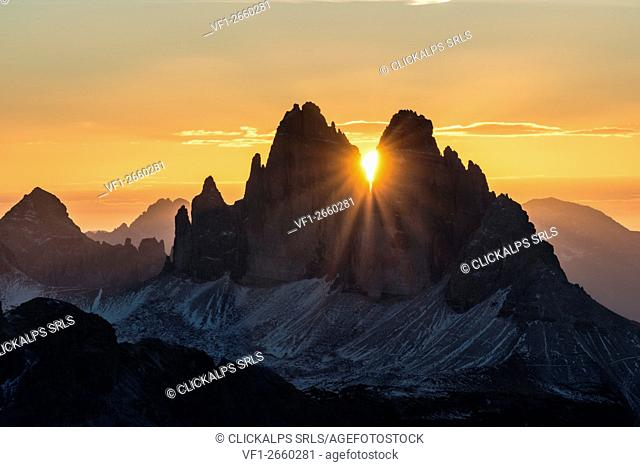 Picco di Vallandro, Prato Piazza, Dolomites, South Tyrol, Italy. The sun rises exactly in between the crags of the Tre Cime di Lavaredo