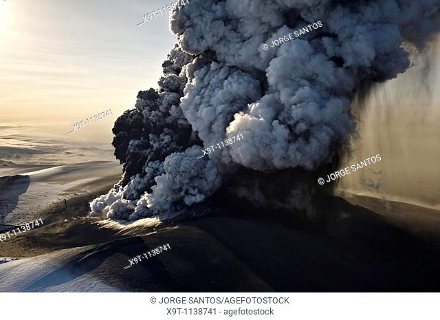 Image of the phreatic explosions at sunrise that produced substantial amounts of ash, steam and Ice