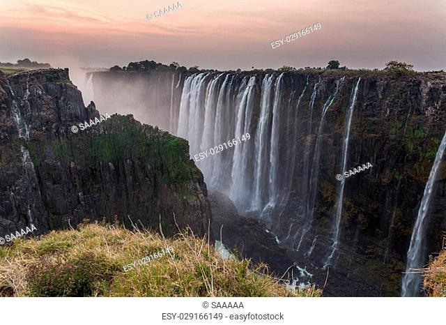Victoria Falls dusk, view from Zambia with rocks