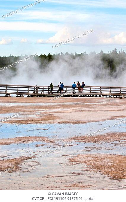 People on a boardwalk at Upper Geyser Basin, Yellowstone National Park