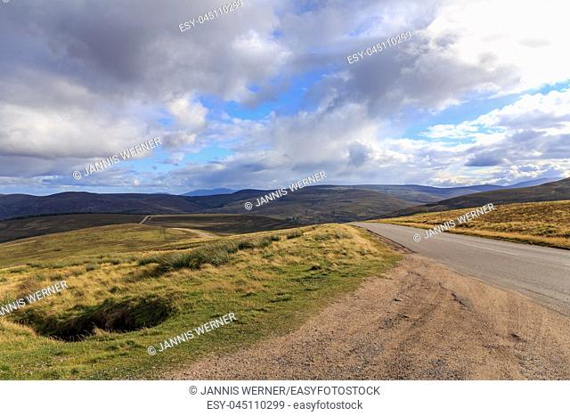 Lonely highway through the Cairngorms national park in Scotland, UK