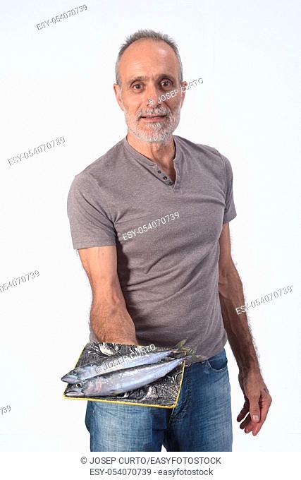 man with mackerel on white background