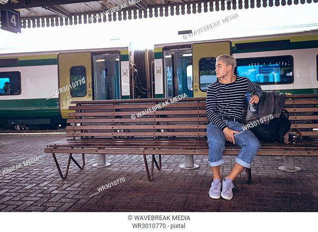 Thoughtful man sitting on bench