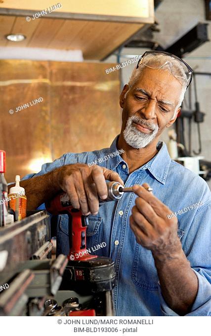 African man working in metal shop