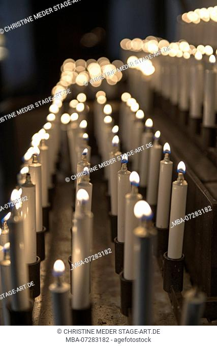 white liquid wax offer candles, votive candles
