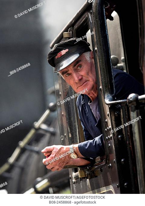 engine driver of a vintage steam locomotive at Loughborough station, on the Great Central Railway in Leicestershire,UK