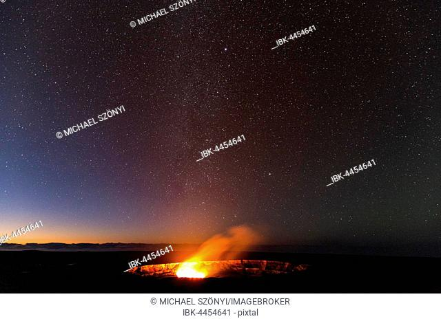 Milky Way above Halema'uma'u crater eruption, Kilauea volcano, Hawai'i Volcanoes National Park, Big Island of Hawai'i, USA