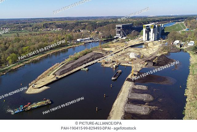 15 April 2019, Brandenburg, Niederfinow: View of the construction site of the new ship lift (r) and the old lift (l, aerial view with a drone)