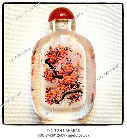 A gift bottle from China with an inlaid painting and name