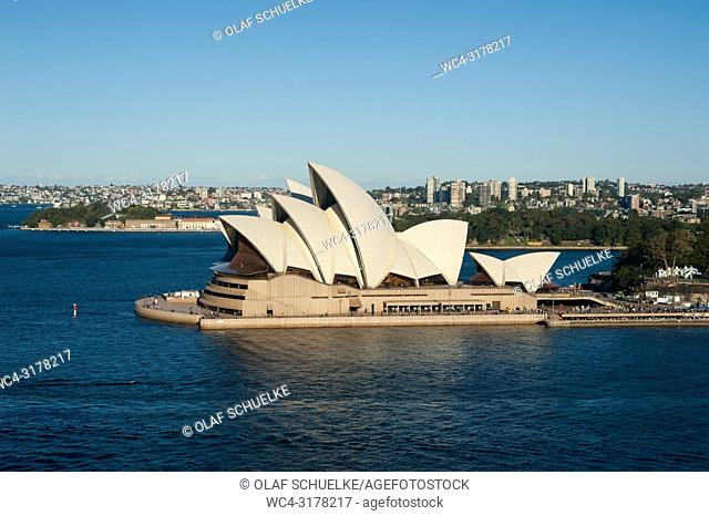 Sydney, New South Wales, Australia - An elevated view of the Sydney Opera House on Bennelong Point with the bay and the entrance to the Sydney Harbour