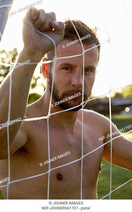A man standing next to a soccer goal, Denmark