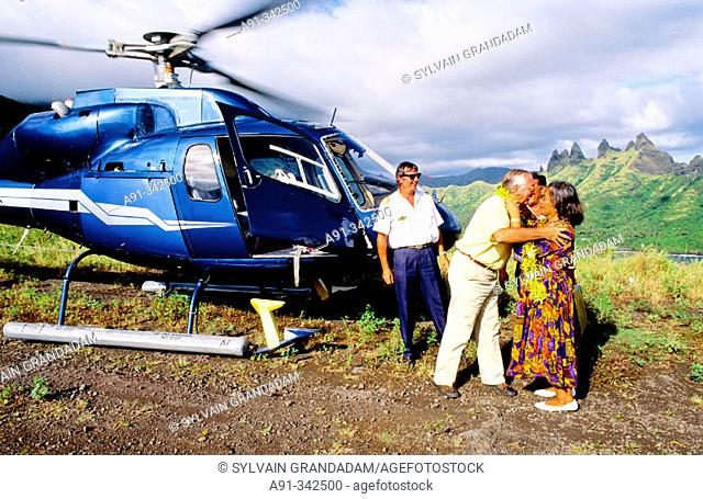 Gaston Flosse President of the Polynesia until february 2005 visiting Hatiteu in helicopter and greeted by Mrs Tata Yvonne local mayor
