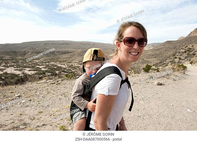 Mother and young son hiking in Big Bend National Park, Texas, USA