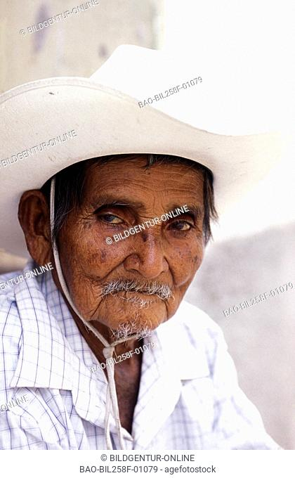 A mountain farmer in the lanes of Copan in the mountains of Copan in westen from Honduras