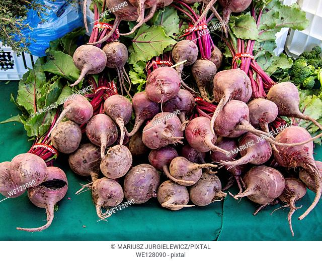 Bunches of fresh organic beetroots for sale at local farmers market