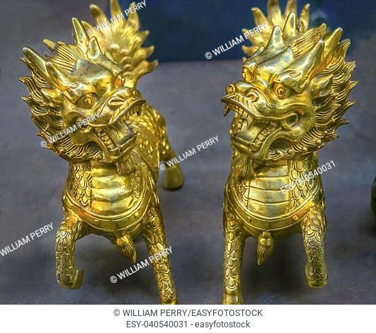 Chinese Replica Bronze Dragons Panjuan Flea Market Decorations Beijing China. Panjuan Flea Curio market has many fakes, replicas and copies of older Chinese...