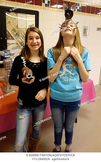 6th Grade Girls Holding Robots, Wellsville, New York, USA