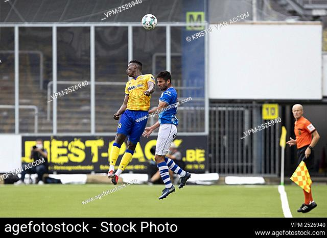 STVV's Ibrahima Sankhon and Gent's Milad Mohammadi pictured in action during the Jupiler Pro League match between STVV and KAA Gent, in Sint-Truiden