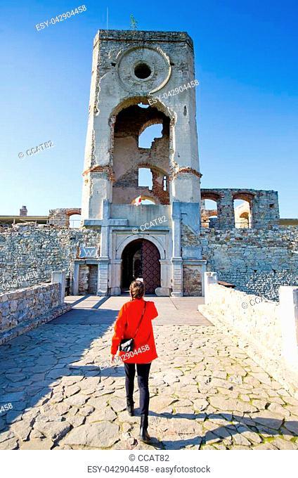 Young woman and Krzyztopor castle - Poland