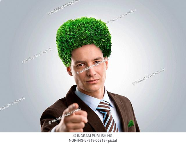 Man with green tree instead of hair. Ecological mind concept