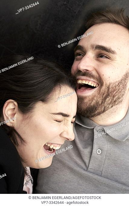 portrait of happy couple laughing