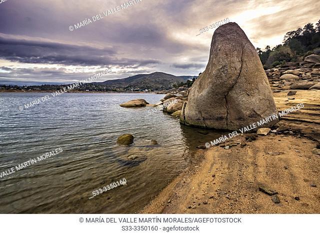 Granite rocks by Burguillo reservoir at sunrise. Avila. Spain. Europe