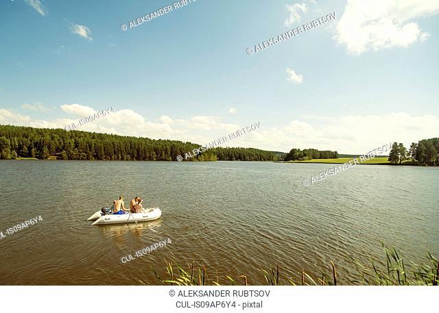 People in dinghy, Rezh River, Sverdlovsk Oblast, Russia