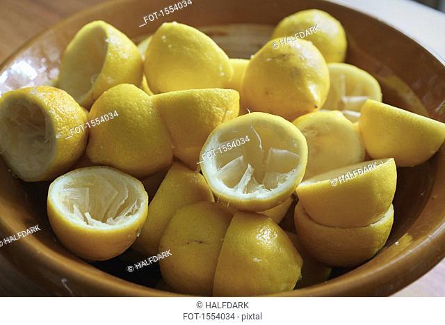Close-up of juiced lemon halves on plate