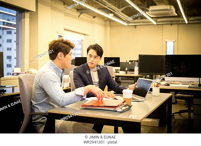 Two serious businessmen