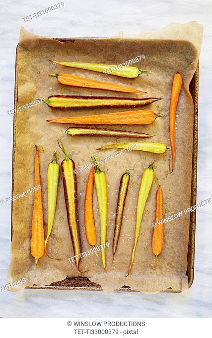 Sliced carrots on baking sheet