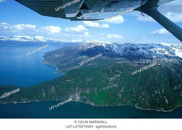 Aerial view from aeroplane window of dramatic Norwegian coastline