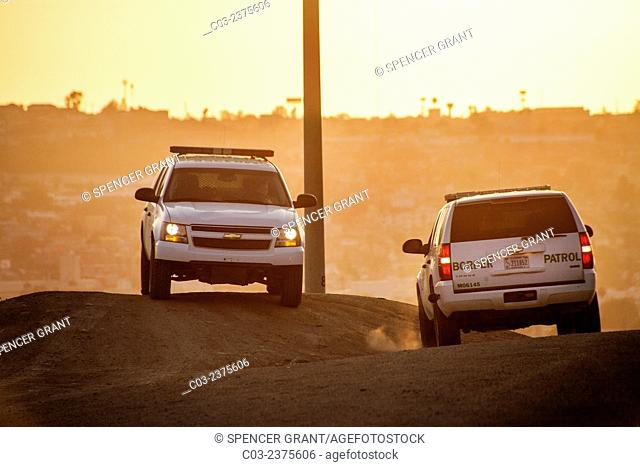 Two Border Patrol SUVs police the U.S./Mexico Border near Tijuana. The Border Patrol is part of the U.S. Department of Homeland Security