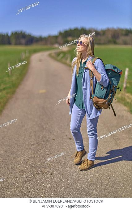 Waakirchen, Bavaria, Germany, fashionable woman walking at country side