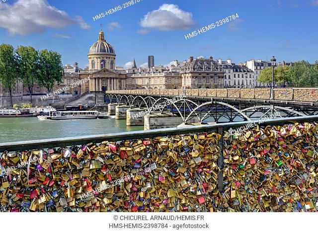 France, Paris, the banks of the Seine river listed as World Heritage by UNESCO and the arts bridge with its love locks