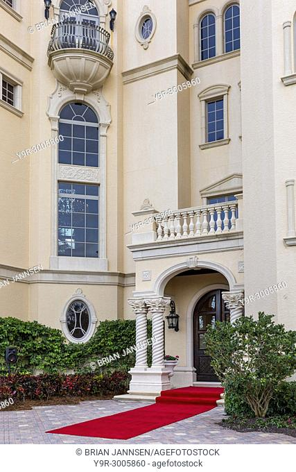 Front of typical wealthy beach front residence Naples, Florida, USA