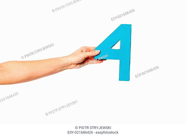 hand holding up the number four from the left