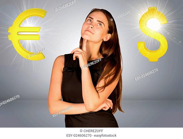 Business woman thinking over dollar sign and euro sign. Gray gradient background