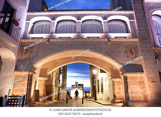 Hight square of Badajoz, illuminated by led lights at twilight. Arco del Peso or Weight Arch