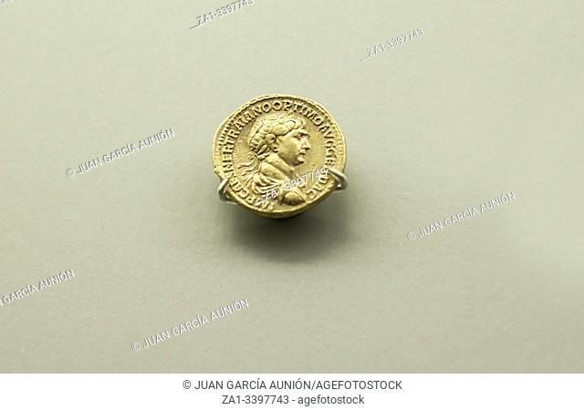 Gold Roman Imperial coin bearing the bust of Emperor Trajan. National Museum of Roman Art in Merida, Spain