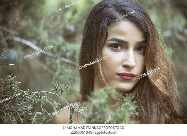 Serious young woman staring outdoors