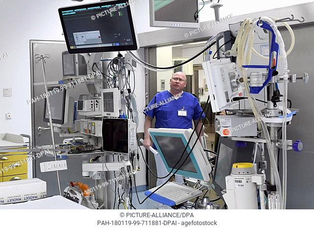 An employee stands inside a modernized heart surgery room if the Modernized heart medicine at Campus Virchow Hospital in Berlin, Germany, 19 January 2018