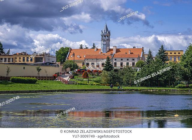 City Hall building in Barczewo town, Warmian-Masurian Voivodeship of Poland. View from so called Prison Pond on Pisa River