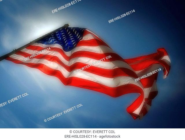 US flag photographed against backlighting from the sun. Ca. 2010