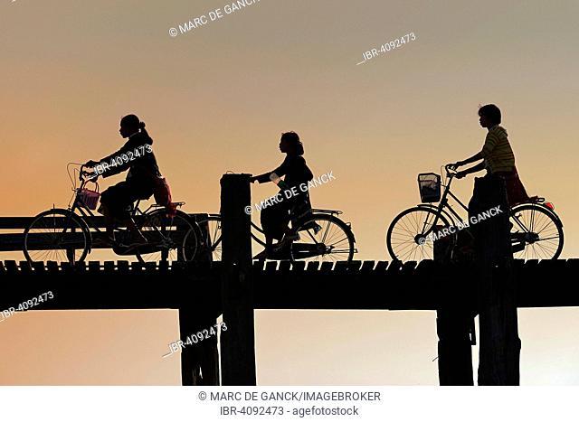 Silhouettes of cyclists, U-Bein bridge, Amarapura, Mandalay, Myanmar