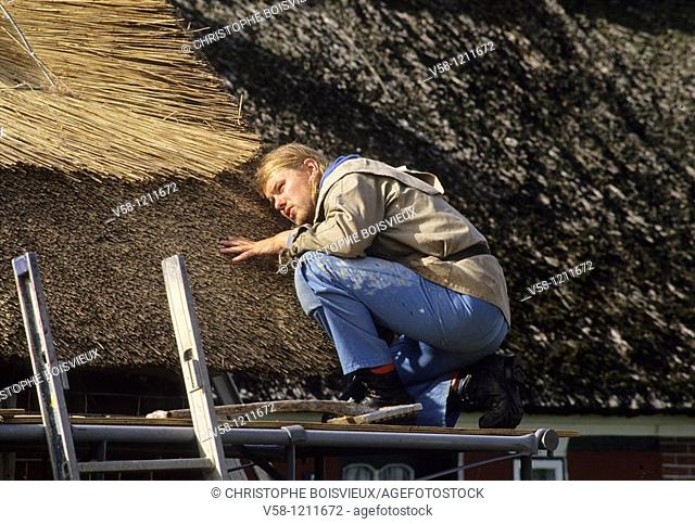 Denmark, Fano Island, Sonderho, Carpenter making a thatch roof
