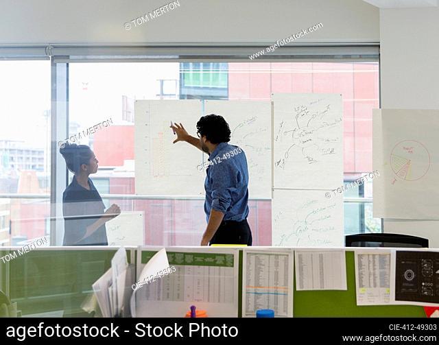 Business people brainstorming in office