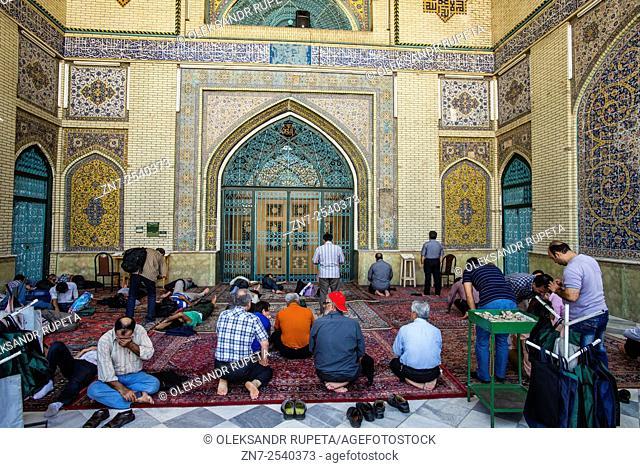 Muslims pray in Imam Khomeini Mosque, Tehran, Iran
